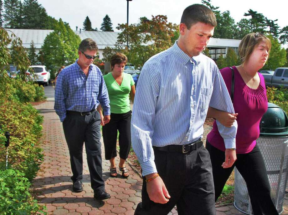 In this 2008 archive photo, the St. Andrews family of Putnam, from left, Jimmy Joe; his wife, Kellie; son Dustin,16; and daughter Brittney St. Andrews, walk into Washington County Courthouse. (Times Union archive) Photo: John Carl D'Annibale / 00000428A