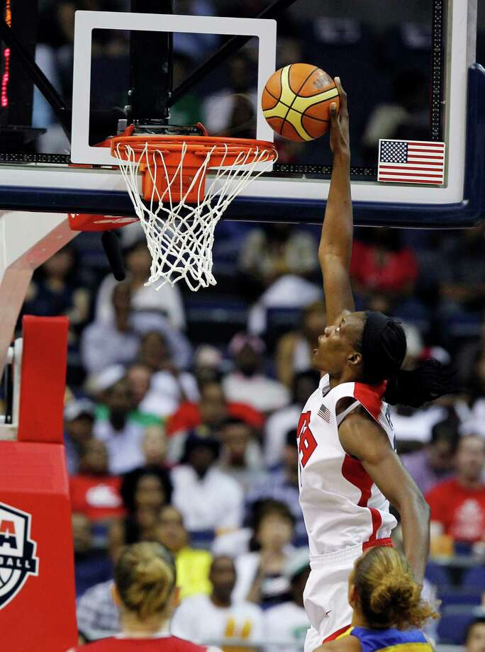Team USA center Sylvia Fowles goes up for a dunk, which bounced out, during the second half of an Olympic women's exhibition basketball game with Brazil, Monday, July 16, 2012, in Washington. USA won 99-67. (AP Photo/Alex Brandon) Photo: Alex Brandon, Associated Press / AP