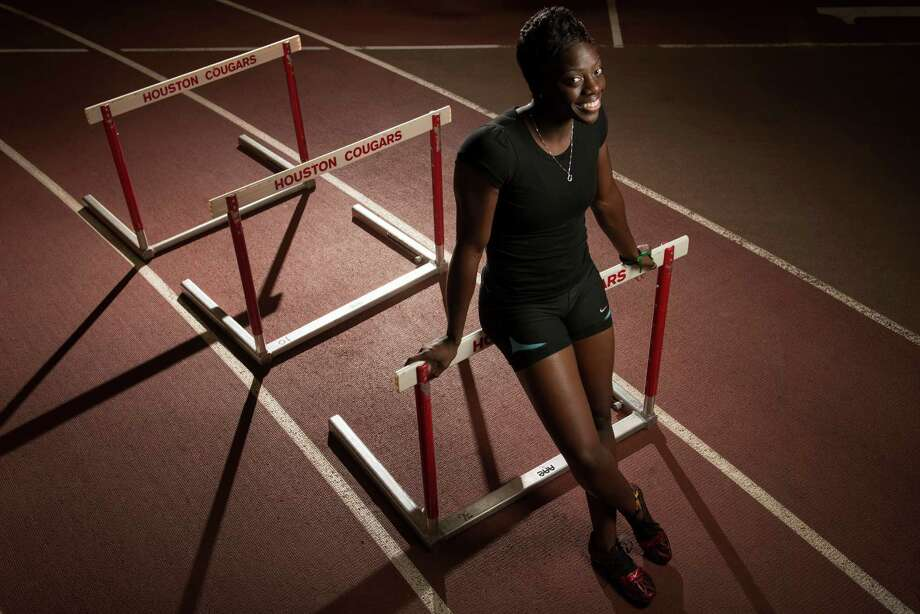Seun Adigun, a former University of Houston standout who is now an assistant track coach there, will compete in the women's 100-meter hurdles for Nigeria. She has had two procedures to remove excess tissue from around her heart. Photo: Smiley N. Pool / ©   Houston Chronicle