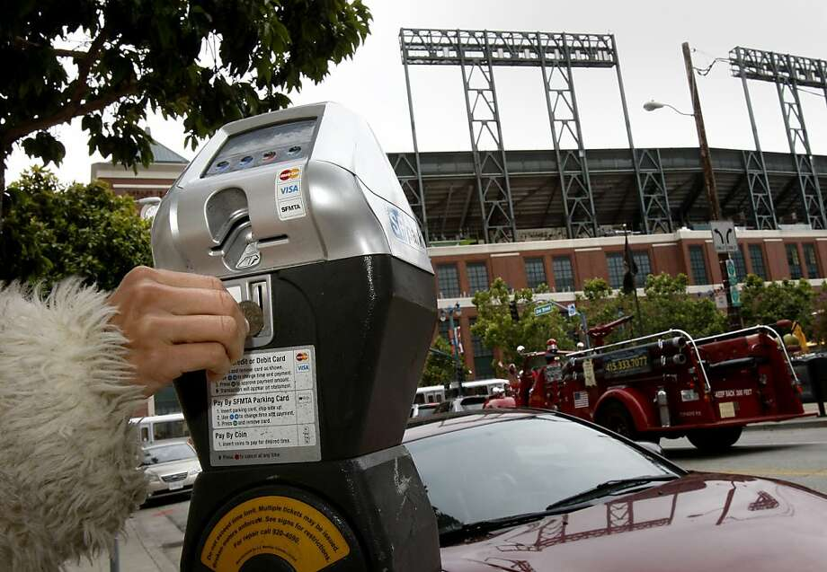 The city will begin planting  hundreds of new parking meters in the area adjacent  to the ballpar. Photo: Brant Ward, The Chronicle