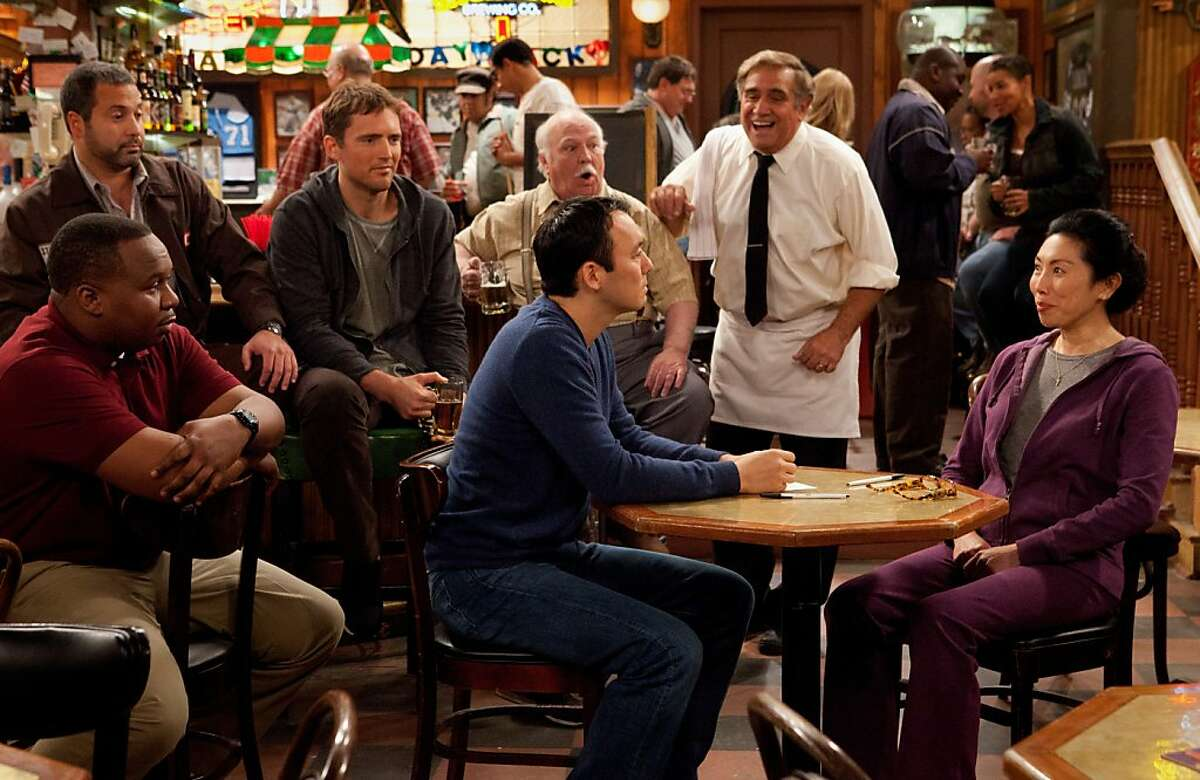 "Steve Byrne talks to Vivian Bang in ""Sullivan and Son."""