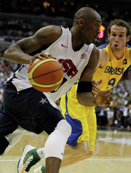Team USA's Kobe Bryant,left, works to get past Brazil defender Marcelo Tieppo Huertas during the first half of an Olympic men's exhibition basketball game, Monday, July 16, 2012, in Washington. Photo: AP