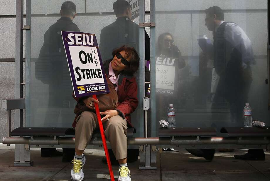 Senior court clerk Flor Maquilan has been working for the court system for 27 years in San Francisco, Calif., on Monday, July 16, 2012, as she takes a break while striking in front of the superior court building.  SEIU Local 1021 has called a strike against SF Superior Court today saying that no information has been given to allow negotiations for a fair contract as workers have been laid off and furloughed with lower wages. Photo: Liz Hafalia, The Chronicle