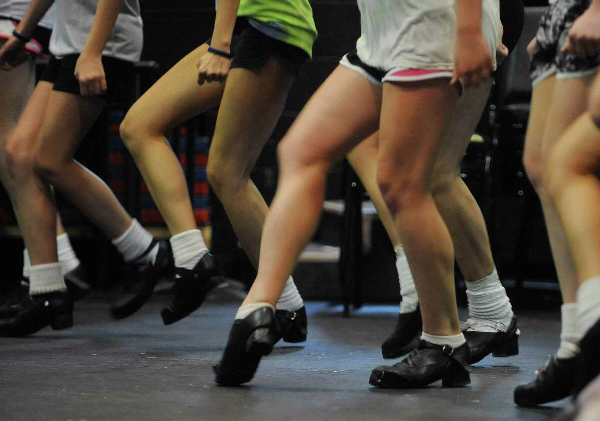 Students in the 15 to 16 year old class run through dance steps during a class at the Camp Rince Ceol, an Irish dance camp, on Monday, July 16, 2012 at Union College in Schenectady, NY. The camp runs a week long and there are three camps held over the next three weeks. This is the 13th year of the camp, the last seven years at Union College. The camp was started by Sheila Ryan-Davoren and her husband Tony Davoren, who were both members of the group River Dance in the mid to late 90's. Along with Irish dance classes students take classes in classical ballet, Irish language, Yoga and Irish music history. This first week has 130 students, some international. The instructors come from the U.S., Australia, Ireland and Scotland. Students range in age from 8 to 18. (Paul Buckowski / Times Union)