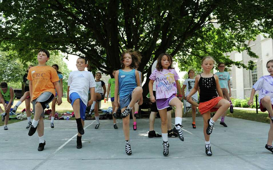 Students in the novice class practice their dance steps during an outdoors class at the Camp Rince C