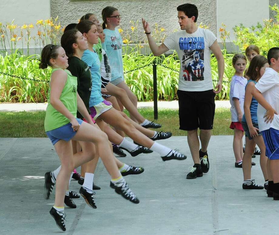 Instructor Craig Ashurst from Australia urges students to come up higher during a class at the Camp Rince Ceol, an Irish dance camp, on Monday, July 16, 2012 at  Union College in Schenectady, NY.  The camp runs a week long and there are three camps held over the next three weeks.  This is the 13th year of the camp, the last seven years at Union College.  The camp was started by Sheila Ryan-Davoren and her husband Tony Davoren, who were both members of the group River Dance in the mid to late 90's.  Along with Irish dance classes students take classes in classical ballet, Irish language, Yoga and Irish music history.  This first week has 130 students, some international.  The instructors come from the U.S., Australia, Ireland and Scotland.  Students range in age from 8 to 18.    (Paul Buckowski / Times Union) Photo: Paul Buckowski