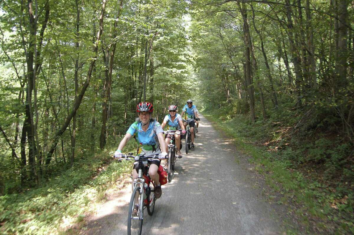 Riders bicycle along the Heritage Rail Trail in Pennsylvania, a former rail bed converted for recreation. A similar proposal is being promoted in the Adirondacks.
