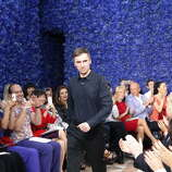 Belgian designer Raf Simons acknowledges the audience at the end of his show for Christian Dior during the Haute Couture Fall-Winter 2012-2013 on July 2, 2012 in Paris. AFP PHOTO / FRANCOIS GUILLOT        (Photo credit should read FRANCOIS GUILLOT/AFP/GettyImages)
