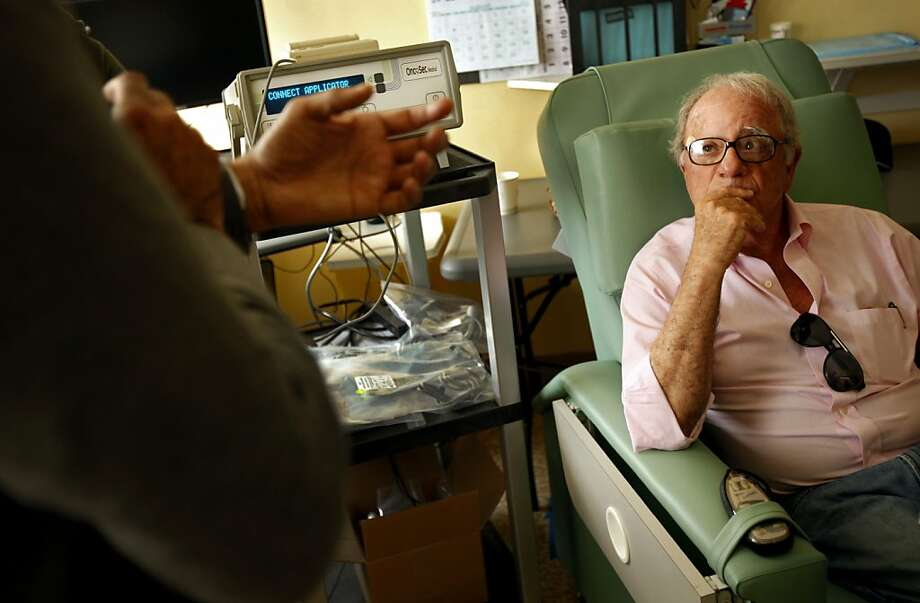Dave Amoroso, 72, of Woodside, talks with Dr. Adil Daud at UCSF Mt. Zion Hospital in San Francisco, Calif., Monday, July 16, 2012.  UCSF is one of three cancer centers nationwide to be testing electroimmunotherapy in clinical trials for the treatment of melanoma.  Amoroso has been receiving the treatment, which targets the tumor with electricity, since March. Photo: Sarah Rice, Special To The Chronicle