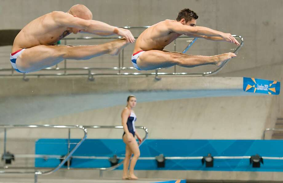 Britain's Nick Robinson-Baker (L) and Chris Mears (R) practice their synchronised diving during a training session ahead of the London 2012 Olympic Games at the Aquatics Centre in the Olympic Park in east London on July 16, 2012. The London 2012 Games officially start on July 27. Photo: Leon Neal, AFP/Getty Images