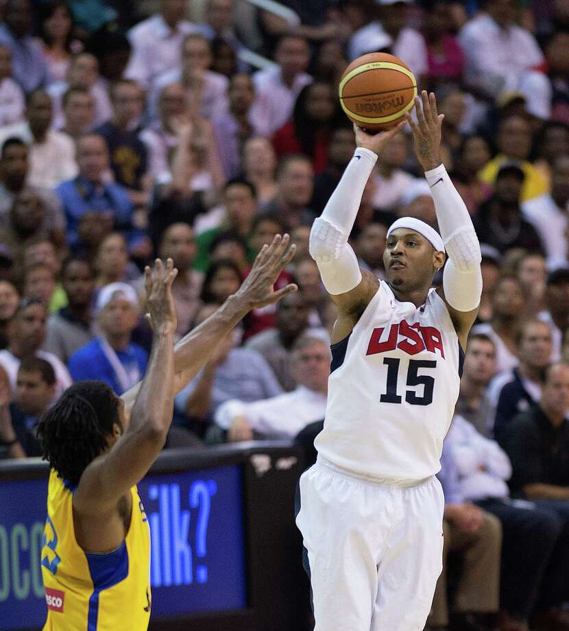 USA's Carmelo Anthony (15) shoots over Brazil's Nene (13) during the second half of their exhibition game at the Verizon Center in Washington, D.C., Monday, July 16, 2012. USA defeated Brazil 80-69. (Harry E. Walker/MCT) Photo: Harry E. Walker, McClatchy-Tribune News Service / MCT