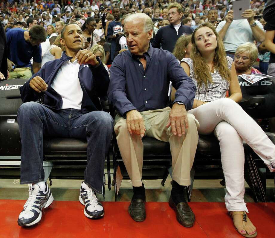President Barack Obama, left, and Vice President Joe Biden and Biden's granddaughter Naomi Biden, right, await the start of an Olympic men's exhibition basketball game between Brazil and Team USA in Washington, Monday, July 16, 2012. (AP Photo/Pablo Martinez Monsivais) Photo: Pablo Martinez Monsivais, Associated Press / AP2012