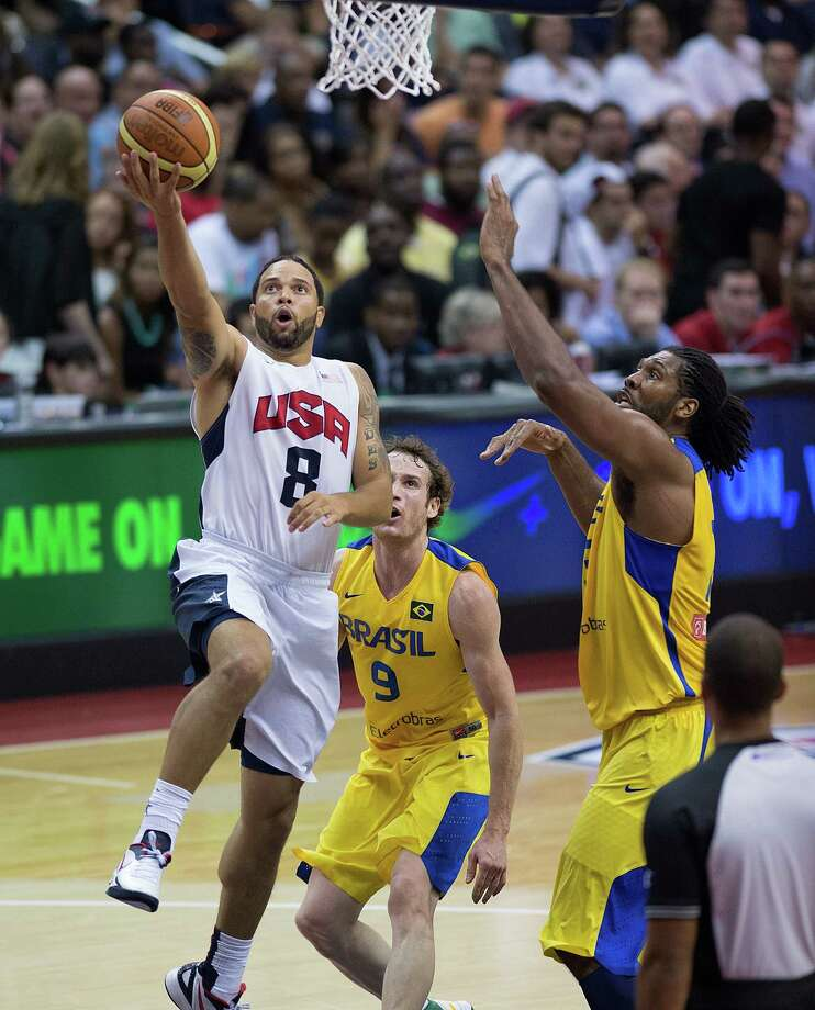 USA's Deron Williams (8) scores over Brazil's Nene (13) during the second half of their exhibition game at the Verizon Center in Washington, D.C., Monday, July 16, 2012. USA defeated Brazil 80-69. (Harry E. Walker/MCT) Photo: Harry E. Walker, McClatchy-Tribune News Service / MCT