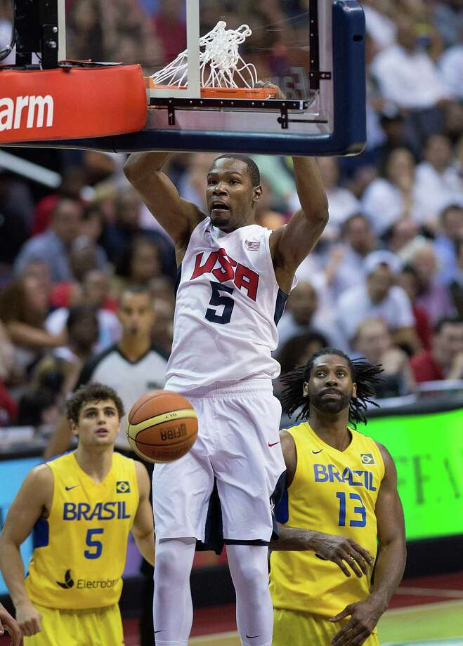 USA's Kevin Durant (5)  slam dunks against Brazil during the second half of their exhibition game at the Verizon Center in Washington, D.C., Monday, July 16, 2012. USA defeated Brazil 80-69. (Harry E. Walker/MCT) Photo: Harry E. Walker, McClatchy-Tribune News Service / MCT