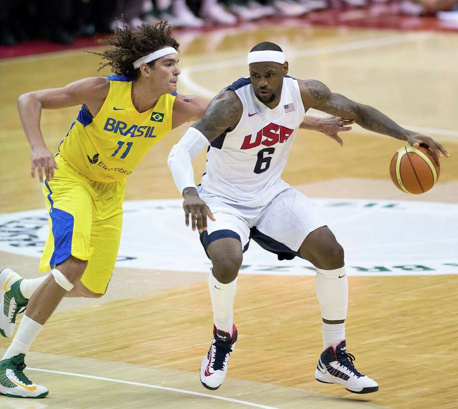 USA's LeBron James (6) is pressured by Brazil's Anderson Varejao (11) during the second half of their exhibition game at the Verizon Center in Washington, D.C., Monday, July 16, 2012. USA defeated Brazil 80-69. (Harry E. Walker/MCT) Photo: Harry E. Walker, McClatchy-Tribune News Service / MCT