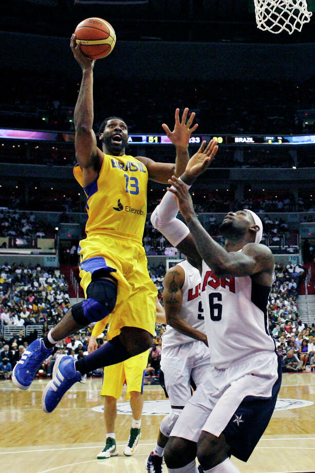 Brazil center Nene goes up over Team USA forward LeBron James during the second half of a men's Olympic exhibition basketball game, Monday, July 16, 2012, in Washington. USA won 80-69. (AP Photo/Alex Brandon) Photo: Alex Brandon, Associated Press / AP