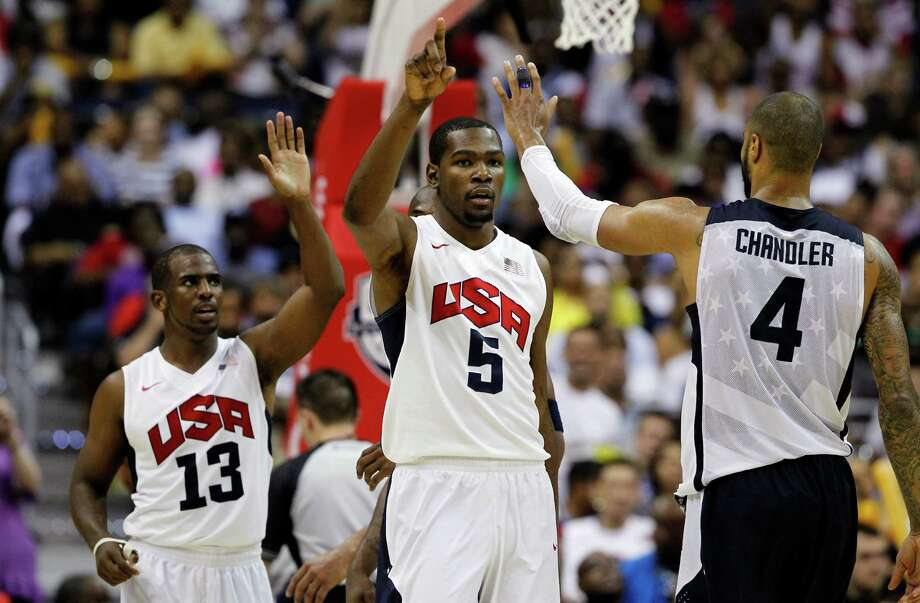 Team USA's Chris Paul (13), Kevin Durant (5), and Tyson Chandler (4) celebrate during the second half of a men's Olympic exhibition basketball game against Brazil, Monday, July 16, 2012, in Washington. USA won 80-69. (AP Photo/Alex Brandon) Photo: Alex Brandon, Associated Press / AP