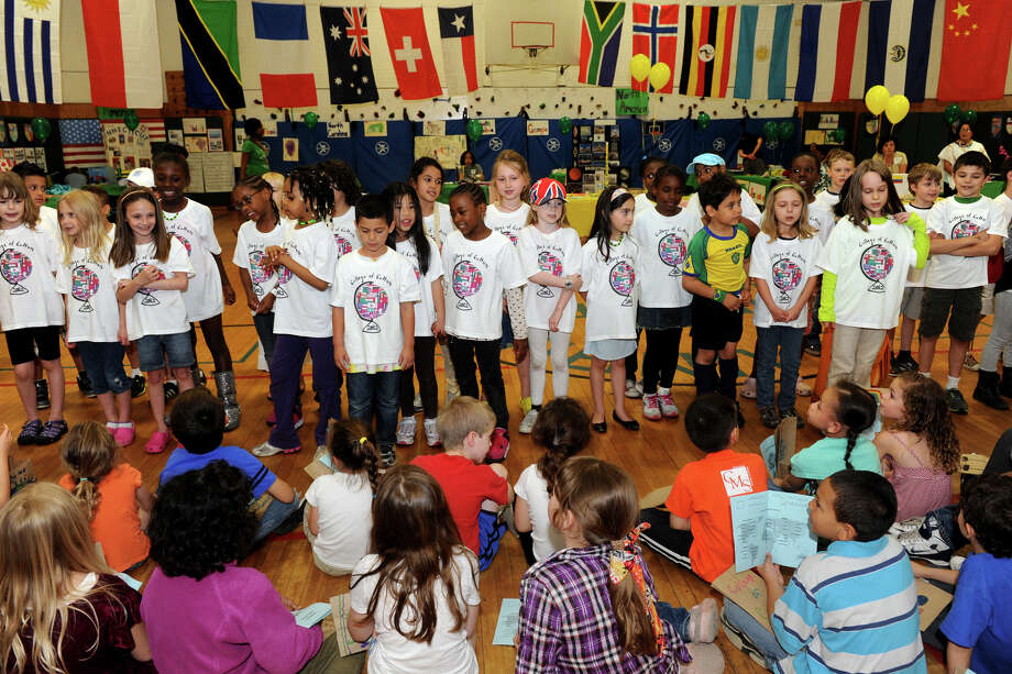 "Students sing ""It's a Small World"" at the beginning of the Collage of Culture Fair at Columbus Magnet School, in Norwalk, Conn. May 24th, 2012. Photo: Ned Gerard / Connecticut Post"