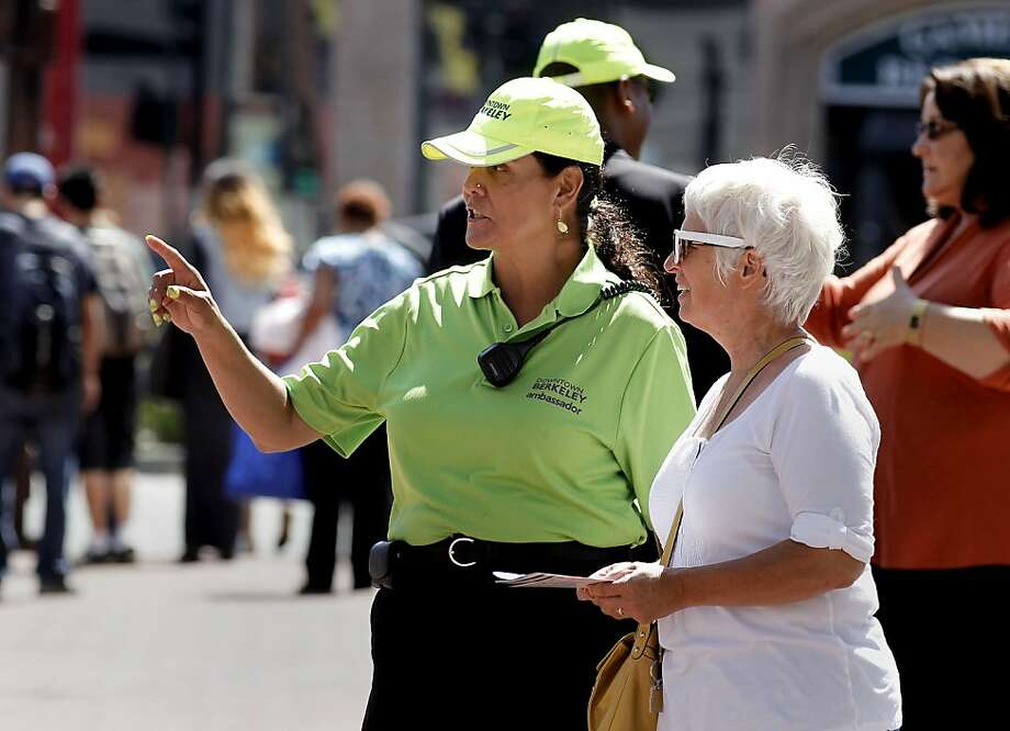 In this file photo, Downtown Business Association Ambassador, Robbi Montoya,  informs tourist Debra Hartman, of Grand Rapids, Mi., along Shattuck Ave., in Berkeley, Calif., on Wednesday July 11, 2012. Photo: Michael Macor, The Chronicle