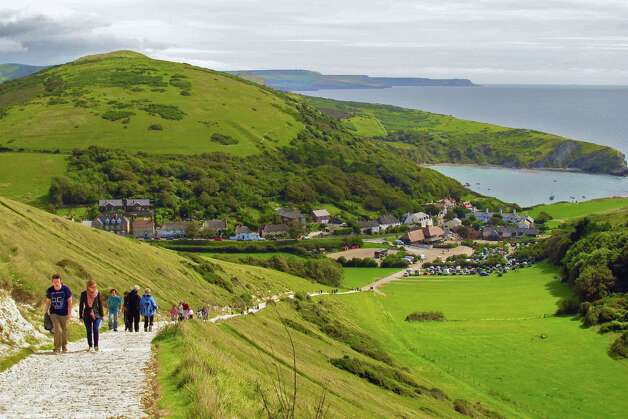 A steep path ascends from Lulworth Cove, one of the quaint villages that dot Dorset's Jurassic Coast. The area will be the site of 2012 Olympic sailing events. Photo: Amy Laughinghouse, For The Express-News
