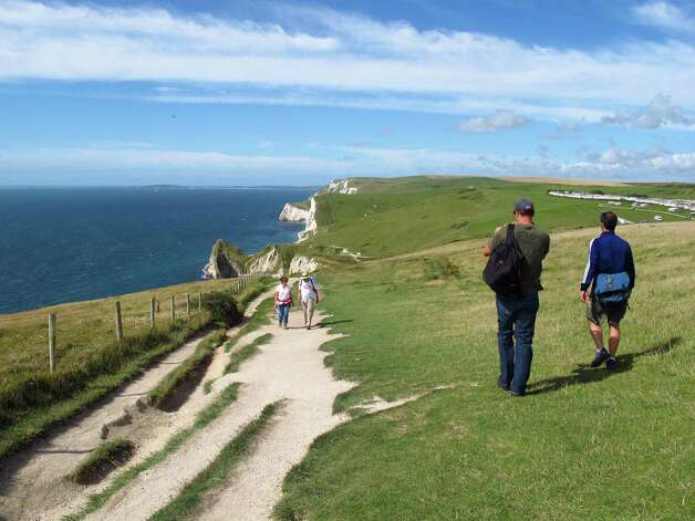 "Dorset's Jurassic Coast boasts ""185 million years of history in 95 miles."" Highlights include undulating, chalky bluffs which rival the famous White Cliffs of Dover.   The area will be the site of 2012 Olympic sailing events. Photo: Amy Laughinghouse, For The Express-News"