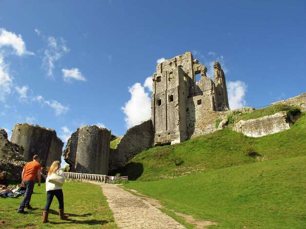 The ruins of Corfe Castle, nestled in the Purbeck Hills, date to the 11th century. The area will be the site of 2012 Olympic sailing events. Photo: Amy Laughinghouse, For The Express-News