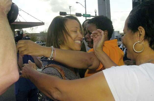 Stacy Walker, left, walks into the arms of family and friends after she and her husband left the Federal Courthouse Thursday afternoon.  U.S. District Judge Ron Clark declared a mistrial in the Calvin Walker federal trial. The 12 person federal jury was deadlocked on reaching a verdict in the case.  Walker, 51, right, the Beaumont Independent School District's electrician of record, was accused of defrauding and overbilling the district by nearly $4 million. He was indicted on 37 federal counts in May. Dave Ryan/The Enterprise