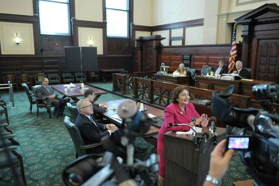 Defense attorney Cheryl Coleman, right, addresses the jury at the Rensselaer County Courthouse on Tuesday, July 17, 2012 in Troy, NY.  Lawyers gave their closing arguments in the trial of Michael Loporto on allegations of ballot fraud in the 2009 Working Families Party primary in Troy.  Also pictured is Special Prosecutor Trey Smith, center, and  Michael LoPorto, background left.  (Paul Buckowski / Times Union) Photo: Paul Buckowski
