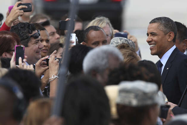 U.S. President Barack Obama smiles as he greets guests and dignitaries upon his arrival at San Antonio International Airport, Tuesday, July 17, 2012. Obama is attending two fundraising events, one at the Convention Center and another one at a private residence in the Dominion. Photo: Jerry Lara / © 2012 San Antonio Express-News
