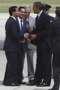 U.S. President Barack Obama greets the Castro brother, St. Rep. Joaquin Castro, left, and Mayor Julian Castro upon his arrival at San Antonio International Airport, Tuesday, July 17, 2012. Obama is attending two fundraising events, one at the Convention Center and another one at a private residence in the Dominion. Behind them is U.S. Congressman Charlie Gonzalez. Photo: Jerry Lara / © 2012 San Antonio Express-News