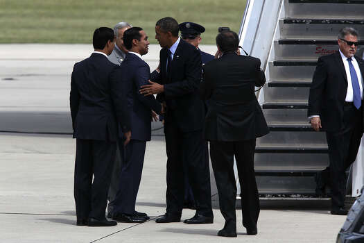 U.S. President Barack Obama greets Mayor Julian Castro and his brother, State Rep. Joaquin Castro upon his arrival at San Antonio International Airport, Tuesday, July 17, 2012. Obama is attending two fundraising events, one at the Convention Center and another one at a private residence in the Dominion.  In back of the brothers is U.S. Congressman Charlie Gonzalez. Photo: Jerry Lara / © 2012 San Antonio Express-News