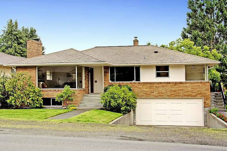 The Broadview neighborhood, in Northwest Seattle, abuts Carkeek Park and Puget Sound, and is full of handsome mid-century homes. Here are four listed there for between $400,000 and $500,000, starting with 709 N.W. 125th St. The 2,200-square-foot brick home, built in 1954, has four bedrooms, two bathrooms with tile counters and floors, tile kitchen counters, picture windows, a lower-level family room with a fireplace, a two-car garage and a patio on a 6,160-square-foot lot. It's listed for $465,000. Photo: Courtesy Steve Hill And Sandra Brenner/Windermere Real Estate