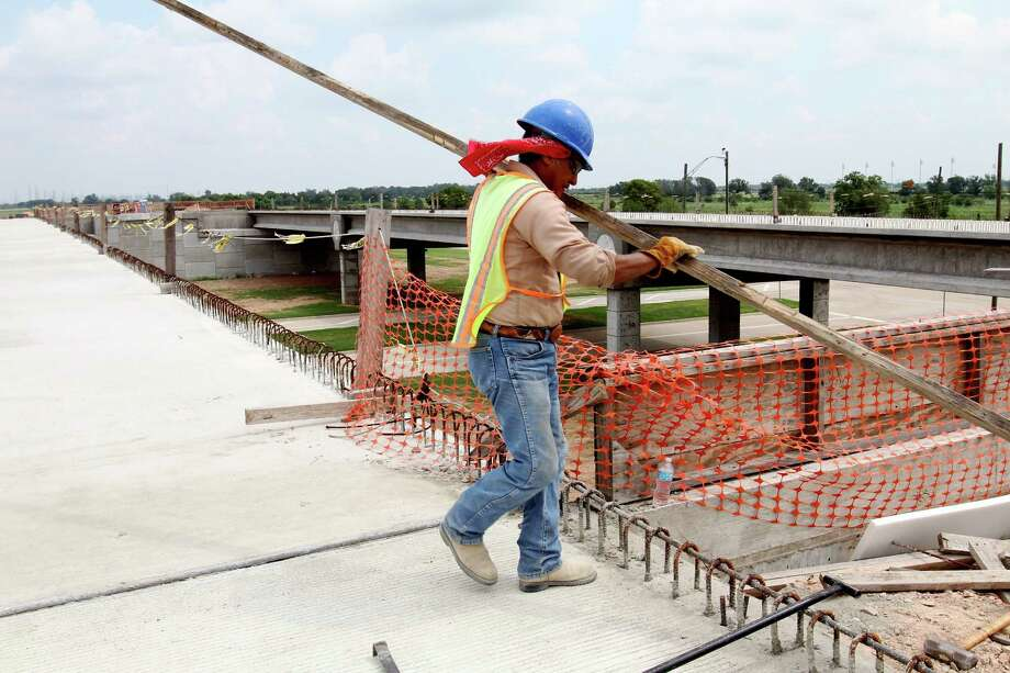 Antonio Olvera works on the tolled overpass being built at West Airport and the Grand Parkway Photo: Suzanne Rehak