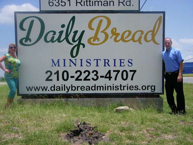 Randy Oliver, owner of Hollywood-Crawford, right, stands with Tammy Baird of Daily Bread Ministries outside the non-profit group's new location on Rittiman Road. Hollywood-Crawford Door Company made a $2,500 donation Daily Bread Ministries to help provide food to those in need in the San Antonio area. Photo: Photo Courtesy Hollywood-Crawford