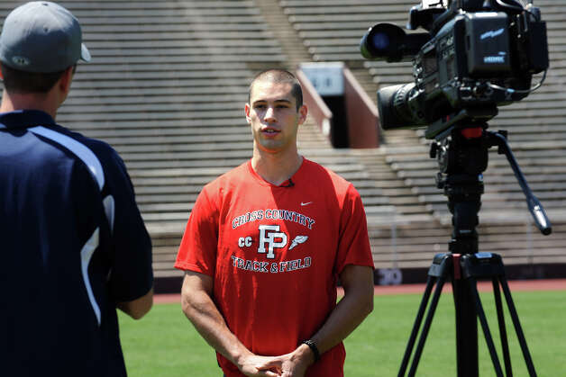 Javelin thrower Craig Kinlsey, of Fairfield, speaks during a television interview prior to practice at Brown University, in Providence, RI., July 10th, 2012. Kinley is going to London as a member of the U.S. Olympic team. Photo: Ned Gerard / Connecticut Post