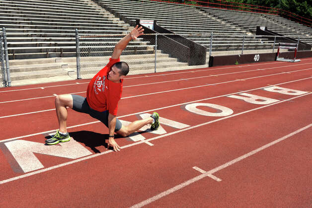 Javelin thrower Craig Kinlsey, of Fairfield, warms up prior to practice at Brown University, in Providence, RI., July 10th, 2012. Kinley is going to London as a member of the U.S. Olympic team. Photo: Ned Gerard / Connecticut Post