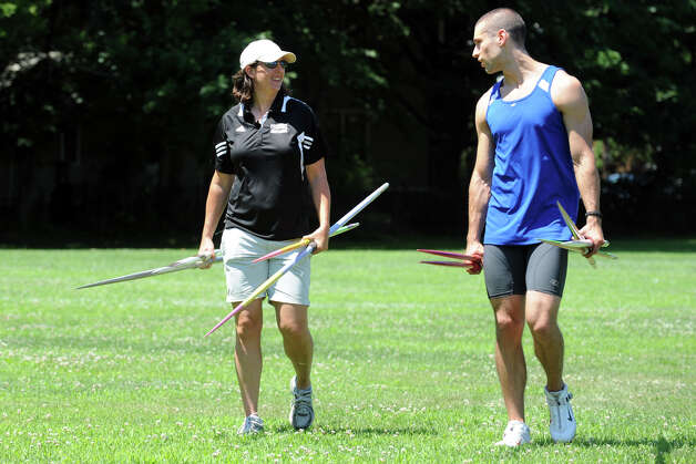Javelin thrower Craig Kinlsey, of Fairfield, speaks with his coach, Michele Eisenreich, during practice at Brown University, in Providence, RI., July 10th, 2012. Kinley is going to London as a member of the U.S. Olympic team. Photo: Ned Gerard / Connecticut Post