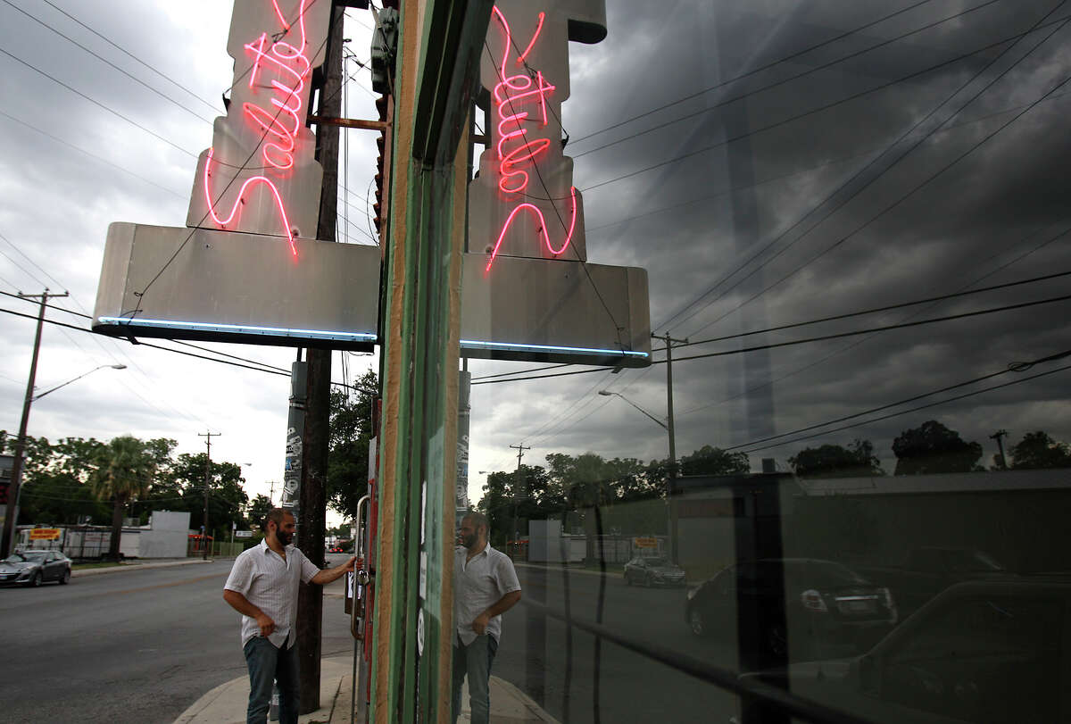 Salute   George Garza Jr. opens the door to Salute. After 25 years, the bar closed its doors on July 28, 2012.