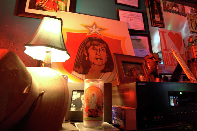 A portrait of Salute owner Azeneth Dominguez, by artist Rigo Luna, sits at the bar Sunday July 8, 2012. After 25 years, the legendary nightclub will be hosting it's last live event on July 21 and closing it's doors on Saturday July 28. Photo: Julysa Sosa / SAN ANTONIO EXPRESS-NEWS