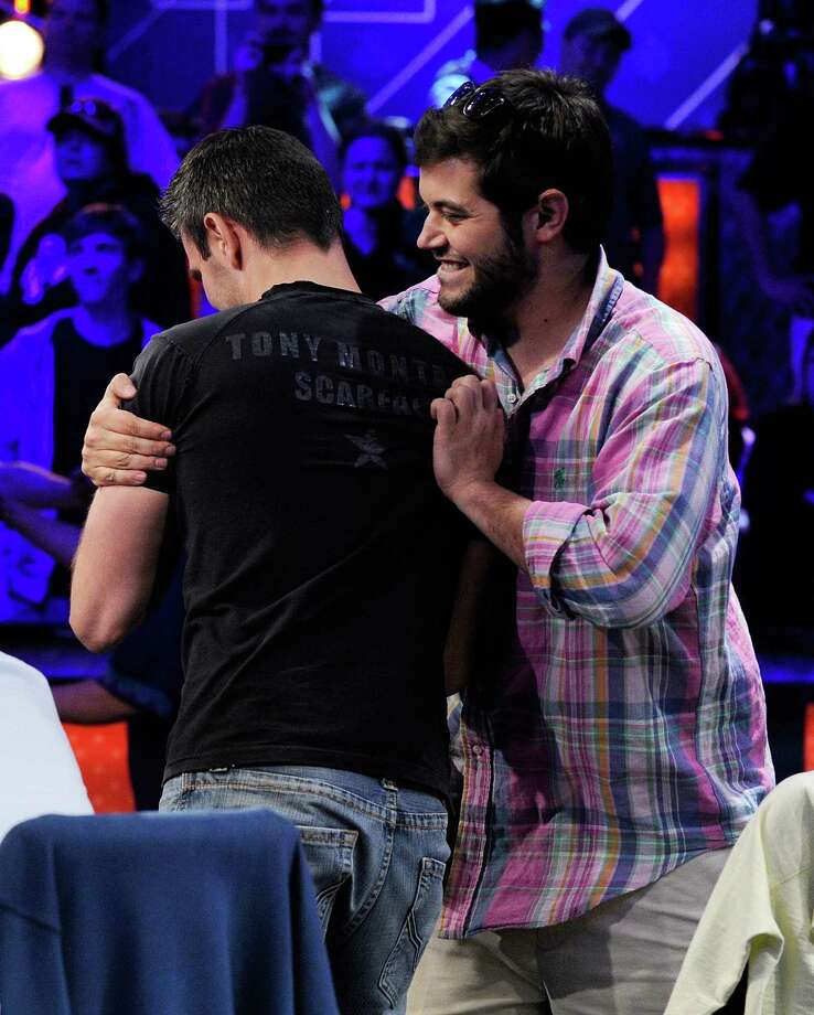 Andras Koroknai, left, is congratulated by Robert Salaburu after winning the final hand of poker during day seven of the Main Event at the 43rd annual World Series of Poker on Tuesday, July 17, 2012 in Las Vegas. The final nine players will return to compete in the final table on Oct. 28 in Las Vegas. Photo: David Becker, AP / FR170737 AP
