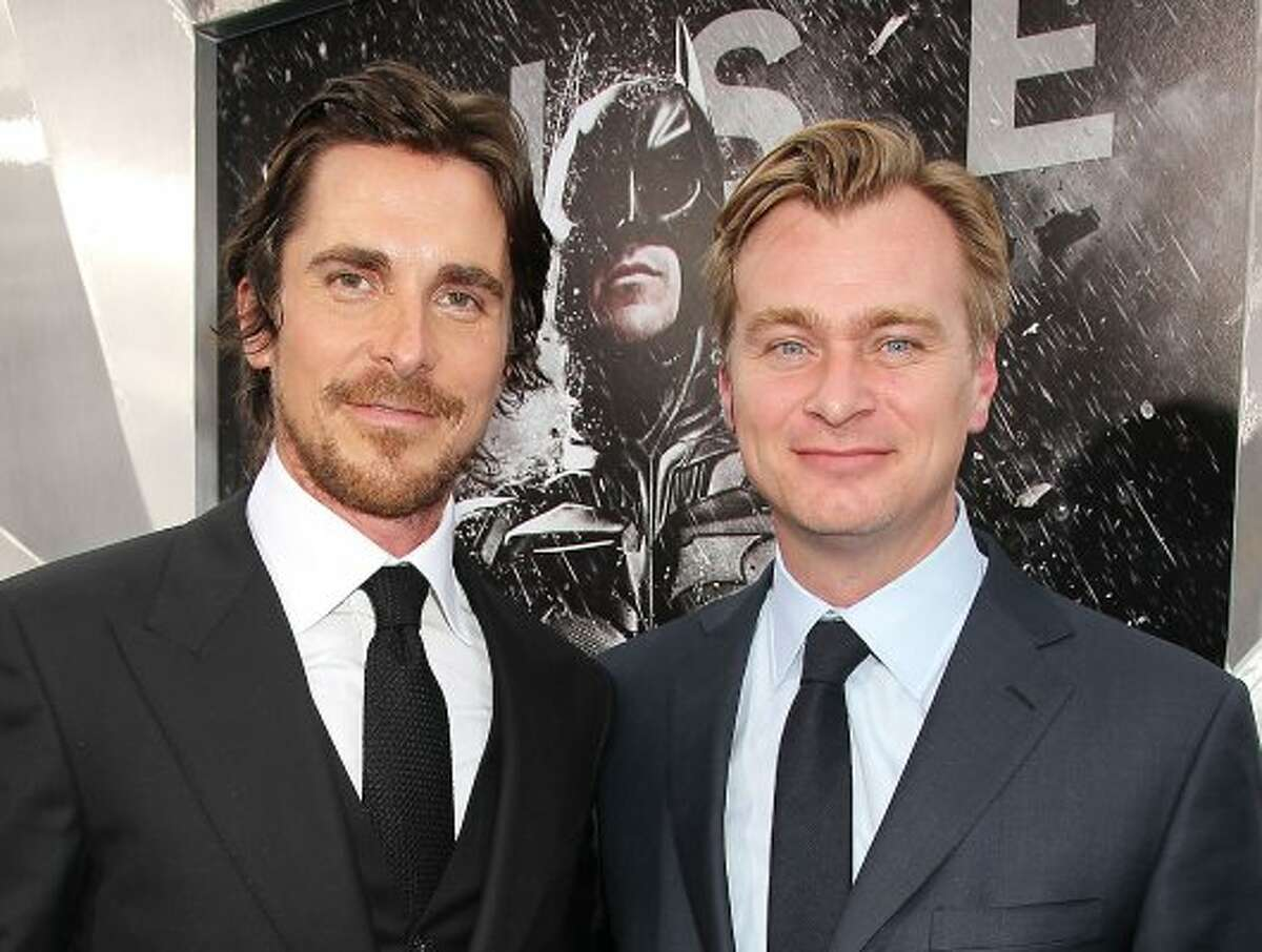 """Actor Christian Bale, left, and director Christopher Nolan at the world premiere of their film """"The Dark Knight Rises,"""" in New York. (Dave Allocca / Associated Press)"""
