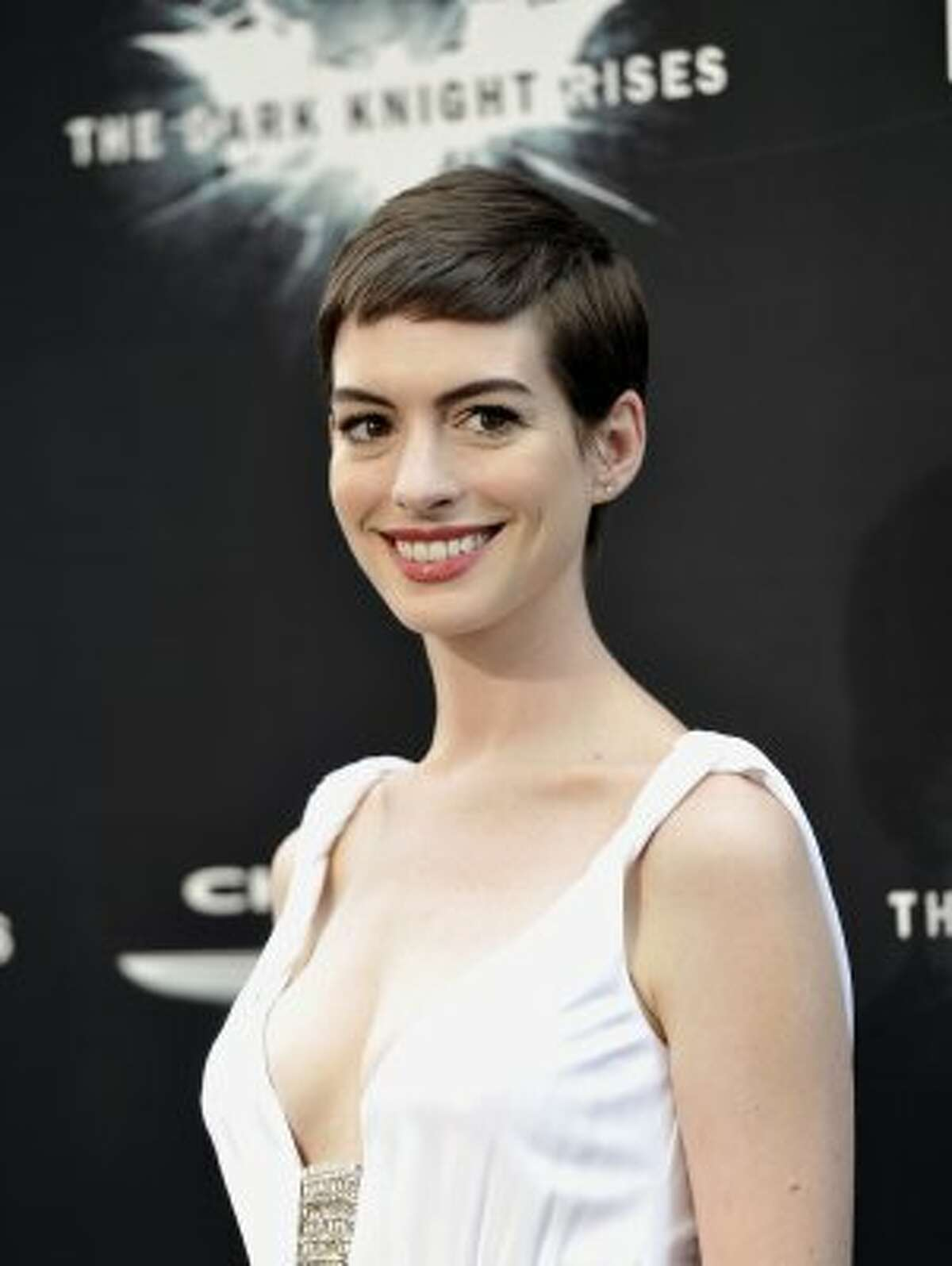 """Actress Anne Hathaway attends the world premiere of """"The Dark Knight Rises"""" at the AMC Lincoln Square Theater on Monday July 16, 2012 in New York. (Photo by Evan Agostini/Invision/AP) (Evan Agostini / Associated Press)"""