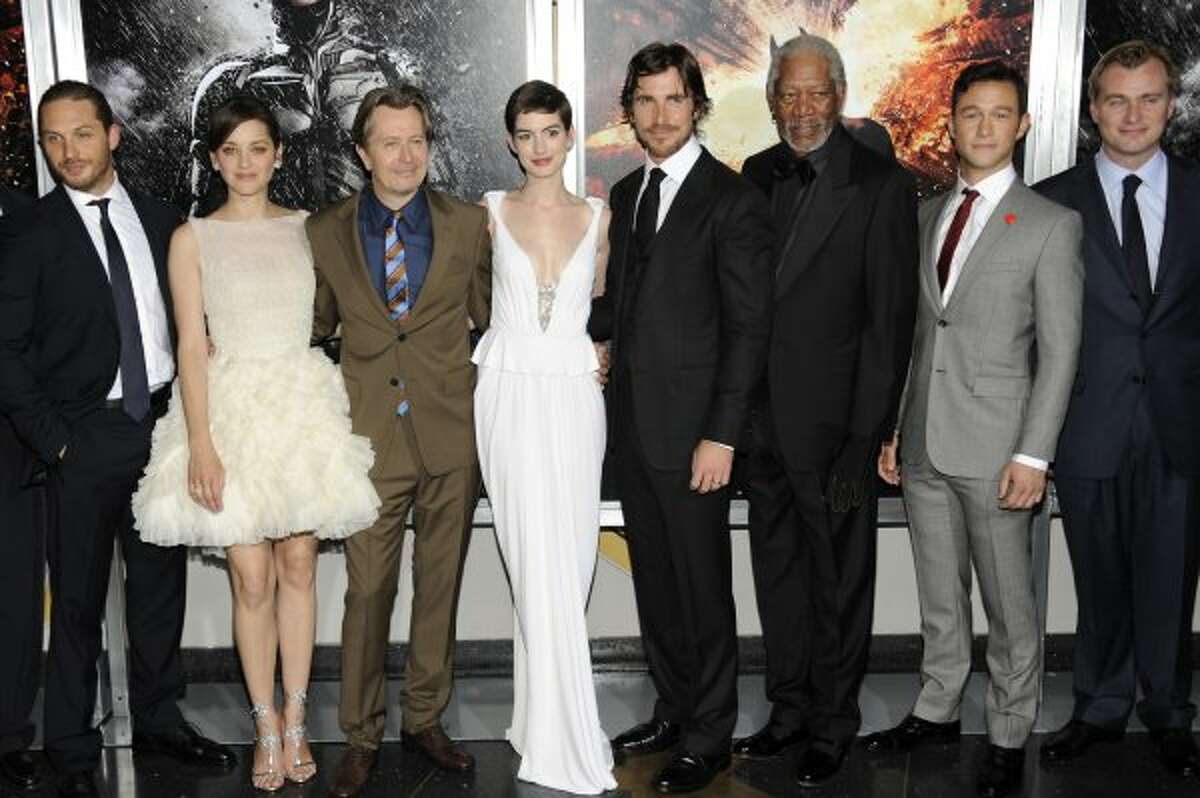 """This July 16, 2012 file photo shows, from left, actors Tom Hardy, Marion Cotillard, Gary Oldman, Anne Hathaway, Christian Bale, Morgan Freeman, Joseph Gordon-Levitt and director Christopher Nolan at the world premiere of """"The Dark Knight Rises"""" in New York. Nolan shot nearly half of his Batman finale using bulky IMAX cameras, whose 70mm frame is about 10 times the size of standard movie film. He also insisted that distributor Warner Bros. release """"The Dark Knight Rises"""" in at least 100 IMAX cinemas that can project it on film rather than in the digital format that has been gradually replacing celluloid. (Photo by Evan Agostini/Invision/AP, file) (Evan Agostini / Associated Press)"""