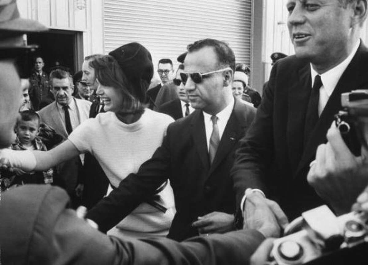 President John F. Kennedy & wife Jacqueline Kennedy at Brooks Air Force Base, in San Antonio, Texas, greeting Air Base personnel & families, November 21, 1963. (Time & Life Pictures/Getty Image)