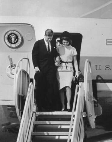 President John F. Kennedy & wife Jacqueline Kennedy arriving at the airport in San Antonio, Texas, November 21, 1963.  (Time & Life Pictures/Getty Image)