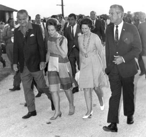 Former President and Texas native Lyndon B. Johnson and his wife Lady Bird Johnson, walk alongside then Texas Governor John Connally and his wife Idanell Connally, July 4, 1968. (Express-News file photo)