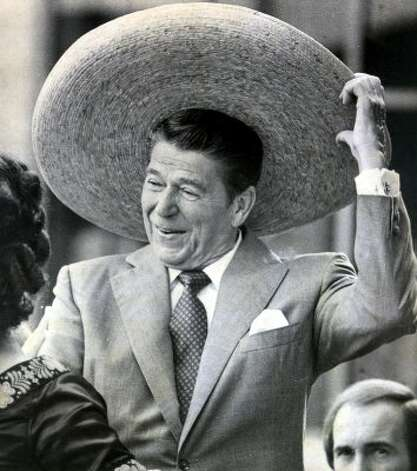 Then republican presidential candidate Ronald Reagan dons a Mexican sombrero as his wife Nancy watches. Reagan brought his campaign to San Antonio and had joined with local residents in the celebration of Mexican Independence Day, September 16, 1980. (Express-News file photo)