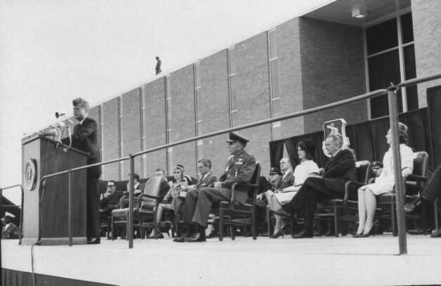 Former U.S. President John F. Kennedy giving a speech at Brooks Air Force Base, in San Antonio, Texas. Seated nearby is Major General Theodore C. Bedwell, Jacqueline Kennedy, and then Vice President Lyndon B. November 21, 1963. Photo: Art Rickerby., Time & Life Pictures/Getty Image / Time Life Pictures
