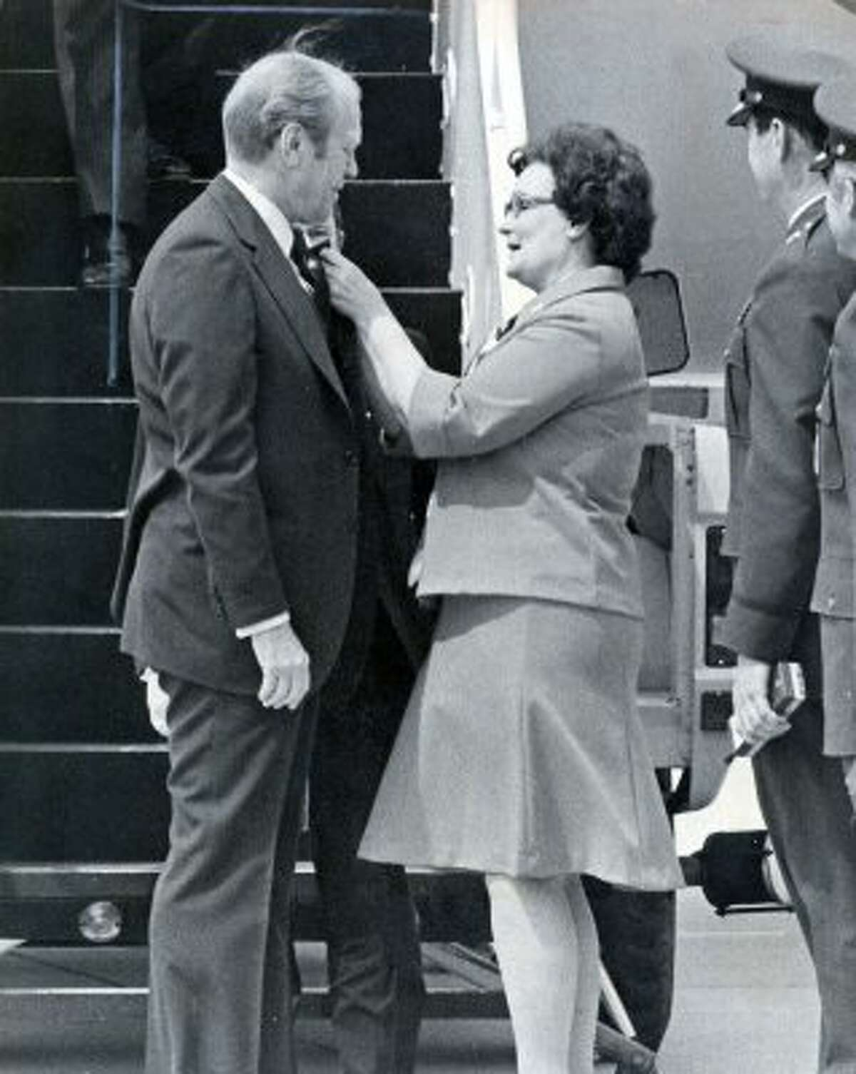 Former U.S. President Gerald Ford being greeted as he exits the plan by former Mayor of San Antonio, Lila Cockrell, April 9, 1976.