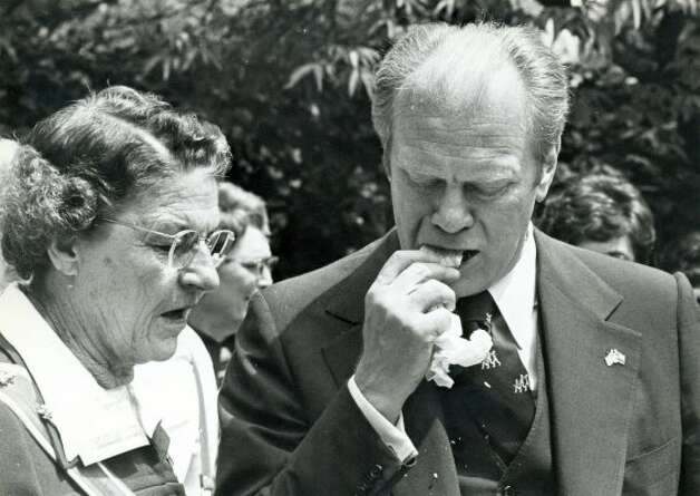 38th U.S. President Gerald Ford eating a tamale in San Antonio, Texas, April 9, 1976. (PAT HAMILTON / Express-News file photo)